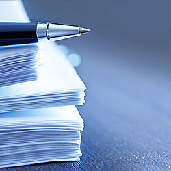 Ballpoint Pen Resting On Top Of Stack Of Documents